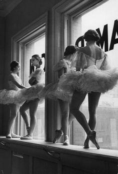 1930s photo taken by photographer Alfred Eisenstaedt of ballerinas leaning against windows in break from from class at American Ballet School, 1936