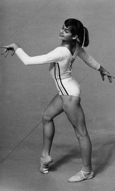 The perfect Nadia Comaneci - Montreal Olympics 1976 Summer Olympics. Nadia Comaneci, age from Romania, was the first gymnast to win a perfect 10 score, and she did it 7 times! She also took home 5 medals, 3 of them gold. 1976 Olympics, Summer Olympics, Vive Le Sport, But Football, My Childhood Memories, Women In History, Olympians, Olympic Games, Back In The Day