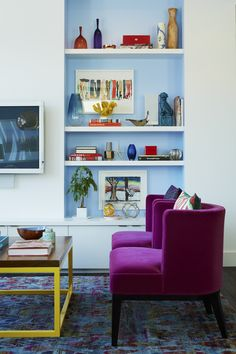 In the New York City living room of Misti Bridges and Stephen Jordan, designer Rayman Boozer created a rainbow-bright palette of blues and berries.