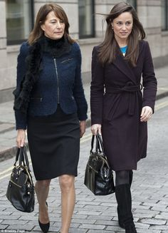Like mother, like daughter: Carole and Pippa Middleton both carried the £195 Modalu bag when visiting the National Portrait Gallery...classy, classy, classy!