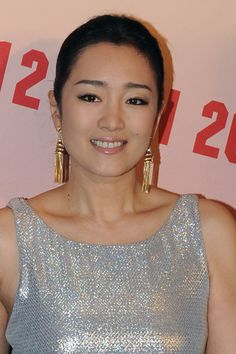 Chinese actress Gong Li poses during the opening ceremony for Louis Vuitton new boutique in Beijing; China; 28 November 2013. Description from thefemalecelebrity.com. I searched for this on bing.com/images