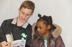 An H-M student reads to younger student from St. Paul.
