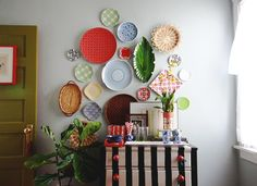 This was a great article about how to do the plate wall with different size/colors. Aunt Peaches: Dinnerware Gone Rogue: How to Hang a Plate Wall