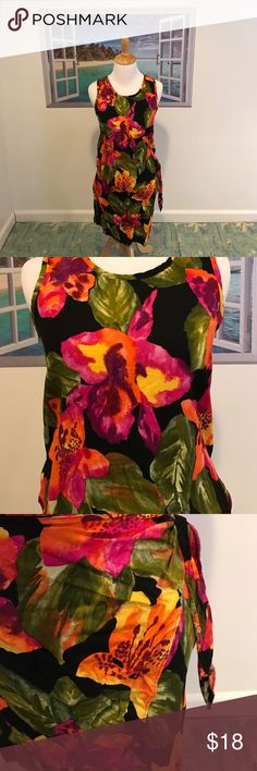 Tropical Beach Cover Up/Top & Skirt Vacation or Beach Ready You Will Be In This Tropical Beach Cover Up/Top & Skirt! Just add a cocktail! Size:Medium. Gently used. Colors are black with green palm leaves, hibiscus flowers yellow, orange, purple, red, fuchsia. Tank top style top. Skirt is elastic pull on waist with a sarong self tie. U are completely covered with skirt self tie is for extra pizazz! 100% rayon. Hand wash. Dry flat or dry clean. NO TRADES. Swim Coverups