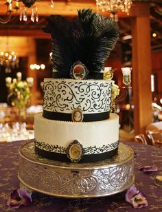 Roaring 20's Wedding Cake, buttercream, black and white, antique cameos, feathers, black ribbon, pearls, scrolls, vintage, Lake Mary Events Center  www.cakedesigners.net