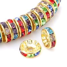 100 Pcs Swarovski Crystal Rondelle Spacer Bead Gold Plated 8mm Multicolor OOOUSE http://smile.amazon.com/dp/B007DK6TGY/ref=cm_sw_r_pi_dp_SopVub11WJN7D