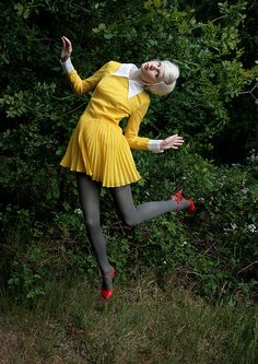 Yellow vintage dress, gray tights, red shoes.
