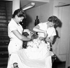 New York Barber School students who learn to shave with straight edge razors on balloons react to the balloons bursting after cutting too close (October 8 1959). [639  629]