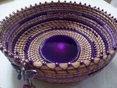 Pine needle basket woven around a purple sliced by CoilMeCrazy
