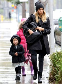 New product! Jessica Alba was carrying her 'first soup to nuts bag design for The Honest Company' - a black vegan leather backpack she claims has 'insulated pockets for snacks and optional changing pad' - With Haven (3) and Honor (6) in Beverly Hills, California.  (January 11, 2015)
