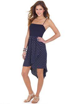Sleeveless polka dot skirt dress with high-low hemline detail. Adjustable straps for better fit.