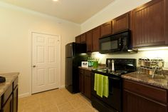 black appliances, toasted almond cabinets, new counter tops