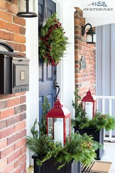 Ideas for easy Christmas porch decor. Winter planter idea using red lanterns. Festive Christmas wreath along with a cozy Christmas sitting area.