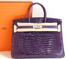 Brand new in box, Hermes Amethyst Shiny Porosus Crocodile Birkiin 35 with Palladium HardwareIncredible! Stunning Rich Bright Amethyst Jewel. The Bag Is New, Never Carried, Comes With All The Accessories,Cites & Box. Including original receipt from the Hermes store, the rain coat, key and clochette.