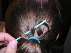 http://www.princesshairstyles.com/2009/09/fancy-woven-ponytail-quick.html