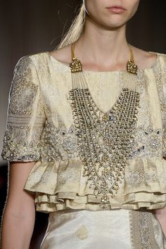 Marchesa gold metallic brocade cropped top with tiers of flounced ruffles, short sleeves, and ornate beadwork.