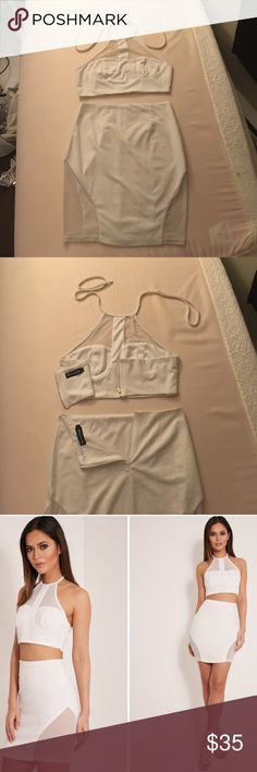 White Halter and High Waist Skirt Co-Ord Two Piece White halter top and skirt with mesh inlets like in the pictures. Size 10 top and bottom. Only worn once, was too loose (I'm normally a size 3/4 US or 6/8 UK but I ordered up). Other