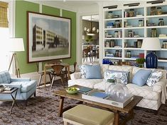 In the family room of a Southampton, New York, house, designer Steven Gambrel painted walls two vivid Benjamin Moore colors — Cedar Green and Marlboro Blue — then made the effect softer by framing them in white. Painted Bookshelves, Cool Bookshelves, Book Shelves, Bookshelf Lighting, Bookshelf Styling, Open Shelves, Wall Shelves, Blue And Green Living Room, Green Rooms