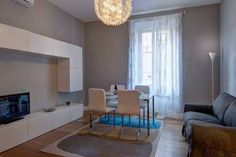 The apartment is located on the 1st floor (no elevator), at 50 meters from the Piramide. The property opens onto the living room, furnished with a sofa, a TV set and a dining table for 4 people. The...
