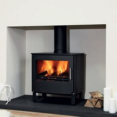 The Westfire Series Two stove incorporates state-of-the art clean combustion system, that gives optimum stove heating performance for a compact stove. The Series Two is available in two styles, either as a traditional stove or as more contemporary slim Fireplace Beam, Fireplaces, Wood Stove Surround, Stoves For Sale, Multi Fuel Stove, Limestone Flooring, Wood Store, Log Burner, Home Living Room