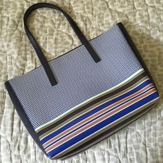 "J. Crew Factory Printed Carrier Tote Gorgeous navy blue tote with a striped and geometric pattern on both sides. Measures 15"" h, 12.5"" w, 6"" deep with a 10"" strap drop. Very minimal wear on the corners, used for about a month. NO TRADES, NO PAYPAL, MAKE OFFERS USING THE OFFER BUTTON. J. Crew Bags Totes"