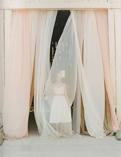Love the blush and ivory sheers for a backdrop or the bride to make her entrance.