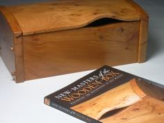 Peter Lloyd - Jewelry box in yew Box No: 1148 Size: 330x230x135mm approx. Description: This box was part of an exhibition whih toured the United States. There was a book - New Masters of the Wooden Box by Oscar P. Fitzgerald - which accompanied the exhibition and this one ended up on the cover!