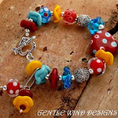 PLAY TIME - Handmade lampwork Beads, All Sterling Silver Beads and Components. $89.00, via Etsy.