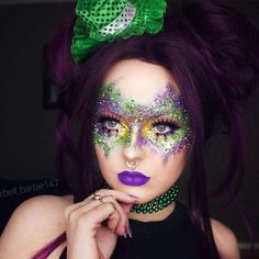 "Another gorgeous Mardi Gras creation using our New Mardi Gras Kit!!!! Absolutely gorgeous.... #Repost @barbell_barbie147 from our friends at @MehronMakeupNYC A little punk themed Mardi Gras look using @mehronmakeup new Mardi Gras kit! I used the metallic purple green and gold with a stippling brush to give the diffused look to the mask. I also used their gold ""glitter mark"" for the gold dots and I used the beads that came in the kit to make a choker Contact us at 585-482-8780 for more inf..."