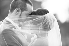 bride and groom pose | veil
