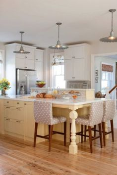 love the idea of the little kitchen table at the end of the island! It would be lower but would still work well...great space for little ones to color  or read while making dinner etc!!!