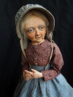 Rebecca Kerin folk art handcrafted dolls.  I own one because I bought it a recent estate sale for $25.00.  I knew it was a treasure.  It turns out they sell in the $400 - $500 range.  Lucky me.