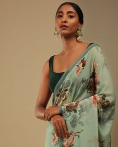 Presenting - 'The Fleur': Sarees for your evening soirees✨ #KALKIGlamFestival Gone Too Soon But Can Be Made For You🛍️ Fog green beauty got sold out real quick! We are sure you wouldn't want to miss this...KALKI gives you the chance to PRE-BOOK THIS SAREE NOW! 😱 Glorify this festive season by gifting yourself this Made-To-Order floral SAREE. Raise the bars high with your flowery look. Fabricated in lush crepe & further enhanced in printed rose motifs.🌹 Style No M01818360Y-SG69131 Saree Trends, Green Saree, Georgette Sarees, Blouse Online, Evening Party, Desi, Kimono Top, Real Quick, Festive
