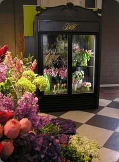 Another refrigerator for a florist store - this one is a beauty! Stunning black in the store's floor space for customers to get a closer look