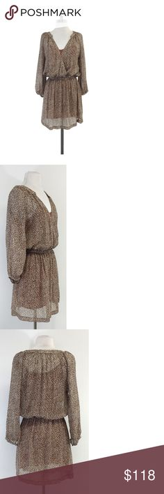 """Joie- Brown & Grey Speckled Print Silk Dress Sz S Brown & grey speckled print dress with plunge neckline, layered slip and gathered waist. Size Small Slips on Snap buttons on neckline Tan slip Some light fabric wear on slip Puff sleeves Shoulder to Hem 34.25"""" The JOIE brand provides the modern, fashion-savvy customer with a global wardrobe based on three elements - casual, comfortable and luxurious. The JOIE aesthetic, both modern and timeless in its appeal, draws its influence from vintage…"""