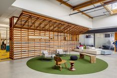 Interesting wall treatment with slats vintage looking slats and AstroTurf looking rug.