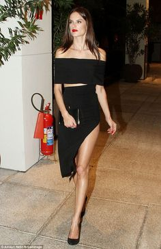 Leggy display: Alessandra Ambrosio looked stunning in a high leg dress at an event in her native Brazil on Thursday night