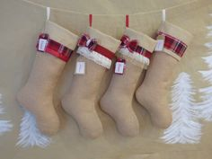 These burlap Christmas stockings have a little red and a little plaid, making them a stylish addition to your favorite red Christmas decor. The