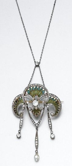 PLIQUE-À-JOUR ENAMEL AND DIAMOND PENDANT-BROOCH/NECKLACE, CIRCA 1900 The lobed foliate motif supporting three fringes, decorated with green and blue plique-à-jour enamel, old European-cut, round and rose-cut diamonds, anchored by a pearl drop, mounted in gold and platinum, suspended from a platinum chain, detachable, length 16 inches. With fitted case.