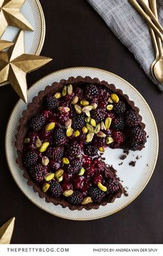 Decadent chocolate, blackberry and pistachio tart that is easy to make and perfect for Thanksgiving or Christmas dinners. Photography by Andrea Van Der Spuy