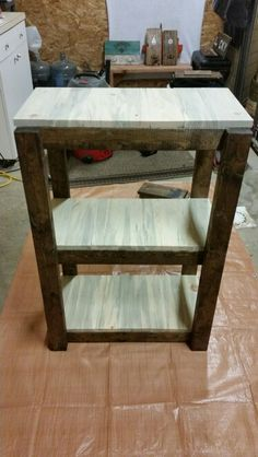 "Wood 3 level shelf. 2' wide 3' tall and 12"" deep"