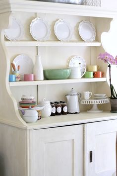Add touches of spring to the dining room with pastels. See how I decorated my hutch for spring.