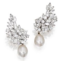 Pair of Platinum, Diamond and Cultured Pearl Earclips  The tops designed as clusters set with round, pear-shaped and marquise-shaped diamonds weighing approximately 12.00 carats, supporting detachable cultured pearl drops measuring approximately 13.8 by 11.1 mm., numbered 285.