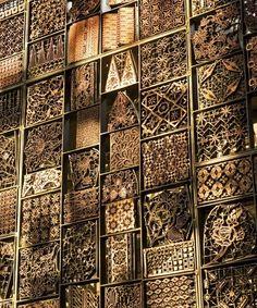 Indonesian tjaps for batik. Detailed metal screen. Alila Villas Uluwatu, Bali