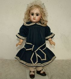 Wonderful all original French navy blue wool bebe doll dress from the 1880's.  Perfect for JUMEAU or other French BEBE doll. Features a rounded