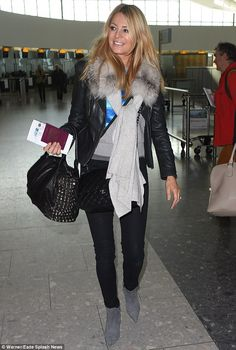 English rose: Tess looked radiant as she walked through check-in wearing a vibrant black a...
