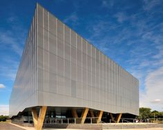 Perforated cladding from Proteus Facades has helped award-winning architect Broadway Malyan create a striking aesthetic for the £6.4m West Yorkshire History Centre in Wakefield - the architects specified Proteus SC Tray Panel system for the single skin perforated panels that form bold, sweeping diagonal patterns across the façade.
