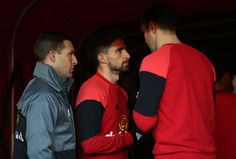 Fabio Borini of Sunderland (C) speaks to John O'Shea of Sunderland (R) in the tunnel prior to coming out to warm up prior to the Premier League match between Sunderland and Liverpool at Stadium of Light on January 2, 2017 in Sunderland, England.