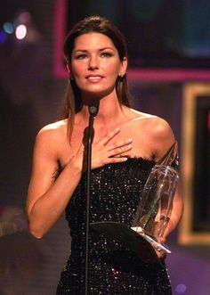 FILE - This Sept. 22, 1999 file photo shows Canadian singer Shania Twain accepting the entertainer of the year award at the Country Music As...