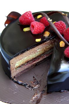 Ambroisie: Chocolate Joconde, Pistachio Joconde, Raspberry Jam, Dark Chocolate Mousse, Pistachio Mousse covered in Chocolate Glaze